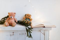 Mantelpiece with a book and Christmas decorations. Mantelpiece with a book and Christmas decorations Stock Photo