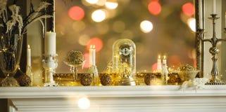 Mantelpiece with Christmas decor. In golden colour Stock Photo