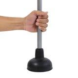 Mantendo o atuador de borracha preto para a bomba de toalete isolado Imagens de Stock Royalty Free