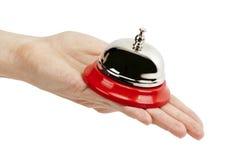 Mantenga la campana en una mano Imágenes de archivo libres de regalías