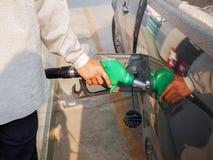 Mantenga la estación del combustible del muchacho Imagen de archivo libre de regalías