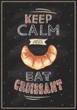 Mantenha calmo e coma o quadro do croissant Imagem de Stock Royalty Free