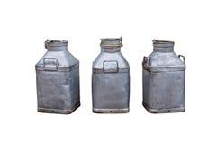 3 mantequeras de leche viejas Foto de archivo libre de regalías