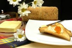 Mantequilla con el caviar Imágenes de archivo libres de regalías