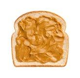 Mantequilla de cacahuete en el pan fotos de archivo