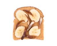 Mantequilla de cacahuete en tostada Fotos de archivo libres de regalías