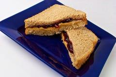 Mantequilla de cacahuete y emparedado de la jalea Imagen de archivo libre de regalías