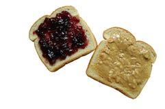 Mantequilla de cacahuete y emparedado de la jalea - aislado Foto de archivo libre de regalías