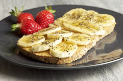 Mantequilla de cacahuete y emparedado del plátano imagen de archivo