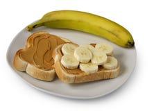 Mantequilla de cacahuete y tostada del plátano Fotografía de archivo