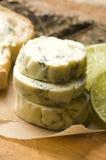 Mantequilla de hierbas con la cal Fotos de archivo libres de regalías