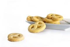 Mantequilla de las galletas en la placa Imágenes de archivo libres de regalías