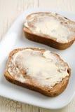 Mantequilla del pan de pasa del cinamomo Fotos de archivo libres de regalías
