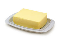 Mantequilla en butterdish gris Fotos de archivo