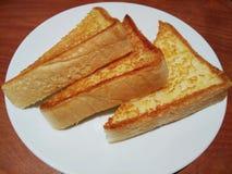 Mantequilla en el pan, tostada Fotos de archivo libres de regalías