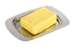Mantequilla en el plato de mantequilla de plata Imágenes de archivo libres de regalías