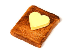 Mantequilla en forma de corazón en tostada Fotografía de archivo libre de regalías
