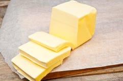Mantequilla en papel de pergamino Foto de archivo