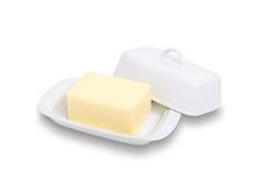 Mantequilla en plato imagen de archivo