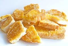 Mantequilla y azúcar de la tostada Imagenes de archivo