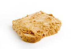 Mantequilla y miel de cacahuete imagenes de archivo