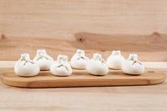 Manti dumplings on a wooden board Stock Photography