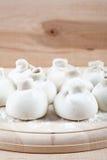 Manti dumplings on a wooden board Royalty Free Stock Image