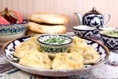 Manti or Mantu are dumplings popular in most Asia cuisines Royalty Free Stock Photo