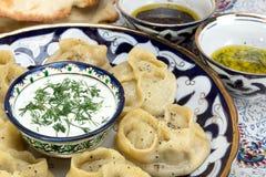 Manti or Mantu are dumplings popular in most Asia cuisines Stock Photo