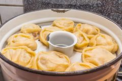 Manti monti or manty mantu manta dumpling popular in kazakhstan caucasus asia afghanistan china and russia ingredients are spiced. Manti monti or manty mantu stock images