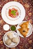 Manti, samosa and tomato salad Royalty Free Stock Image
