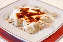 Manti with sauce Stock Photo