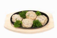 Manti. Traditional Uzbek food in a pan manti stock images