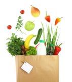 Mantimentos saudáveis em um saco de papel Fotos de Stock Royalty Free