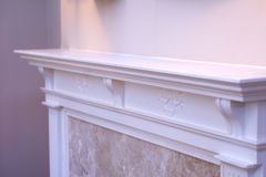Mantle. White fireplace mantle royalty free stock photo