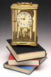 Mantle Clock on Books Royalty Free Stock Photo