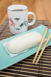 Mantou Chinese steamed bun in green dish on bamboo mat Stock Images