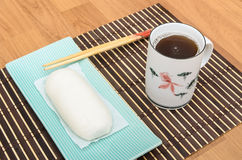 Mantou Chinese steamed bun in green dish on bamboo mat Stock Photography