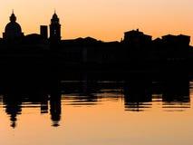 Mantova cityscape. On lake at sunset Stock Photo