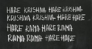 Mantra. The Hare Krishna mantra (Maha Mantra, Great Mantra) on the blackboard stock image