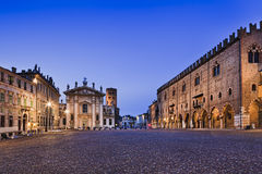 Mantua Square Wide Set. Sordello square at sunset in Mantova's downtown illuminated and empty. Historic landmarks from palaces to churches and castle towers Stock Image