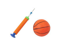 Manual air pump with toy ball Royalty Free Stock Photos