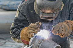 Manual arc welding conical transition with a skirted flange. On mobile stand Stock Images