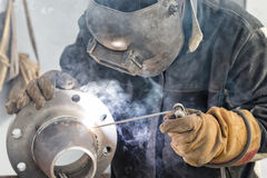Manual arc welding conical transition with a skirted flange. On mobile stand Royalty Free Stock Photos