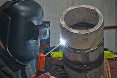 Manual arc welding exam sample stainless steel pipe. Manual arc welding exam sample stainless pipes with high wall-thickness Stock Photo