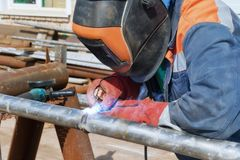 Manual arc welding of stainless steel pipe. Manual arc welding of stainless small diameter pipe Stock Photography