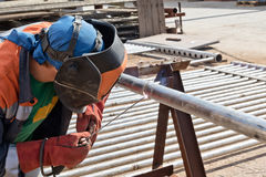 Manual arc welding of stainless steel pipe Stock Photography