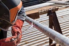 Manual arc welding of stainless steel pipe Stock Photos