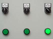 Manual auto switches on control panel with light indicator Royalty Free Stock Image