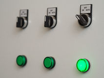 Manual auto switches on control panel with light indicator Royalty Free Stock Photo